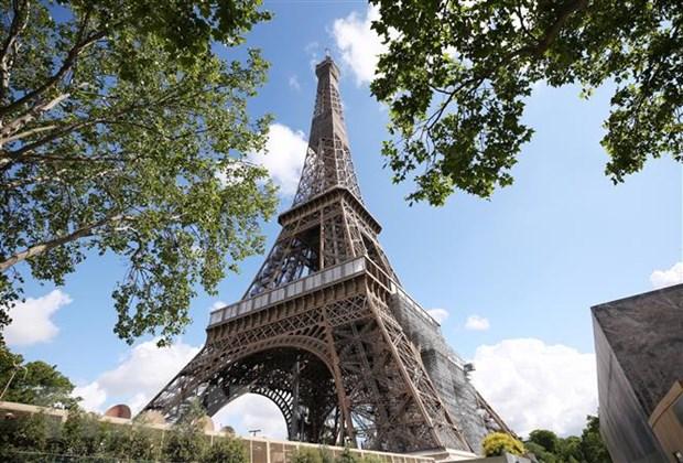 Phap: Thap Eiffel da mo cua tro lai sau de doa danh bom hinh anh 1