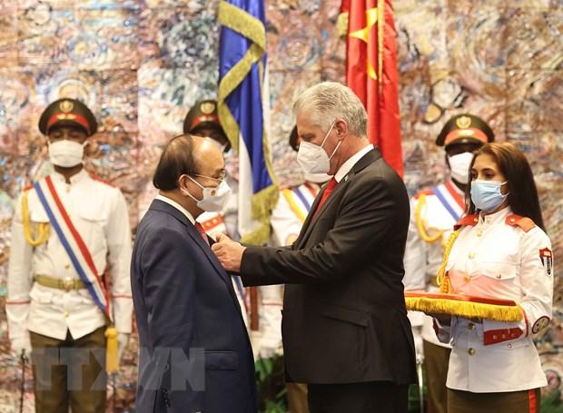 Chu tich nuoc Nguyen Xuan Phuc hoi dam voi Chu tich Cuba hinh anh 3
