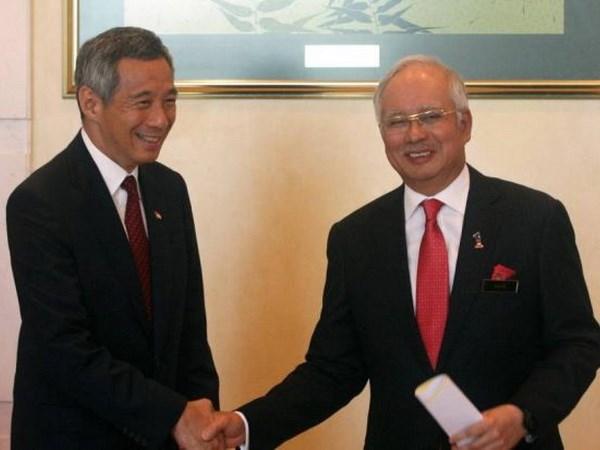 Singapore va Malaysia ky ban ghi nho du an duong sat cao toc hinh anh 1