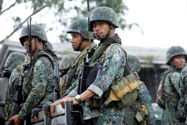 Trung Quoc da trao tang hang nghin khau sung cho Philippines hinh anh 1