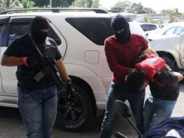Malaysia bat giu 11 nghi can vi tinh nghi co lien quan khung bo hinh anh 1