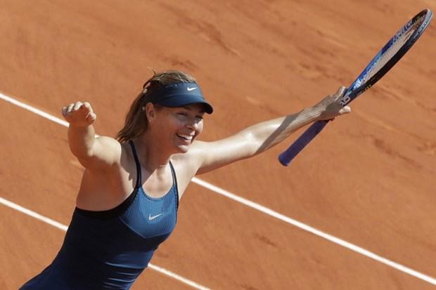 Sharapova bat chien tu nhien thanh, nguoi dep Wozniacki thua soc hinh anh 1