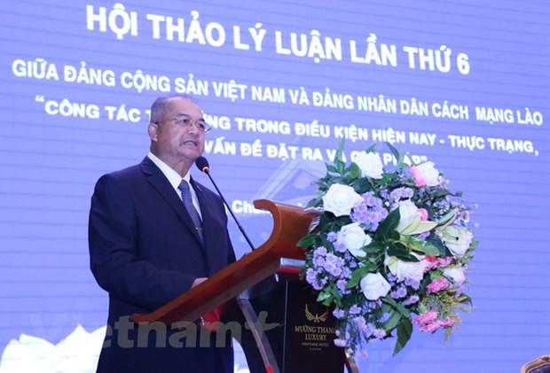 Hoi thao ly luan lan thu 6 giua DCS Viet Nam va Dang NDCM Lao hinh anh 3