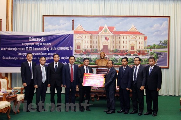 Bo Cong an ho tro 50.000 USD khac phuc hau qua vo dap thuy dien o Lao hinh anh 2