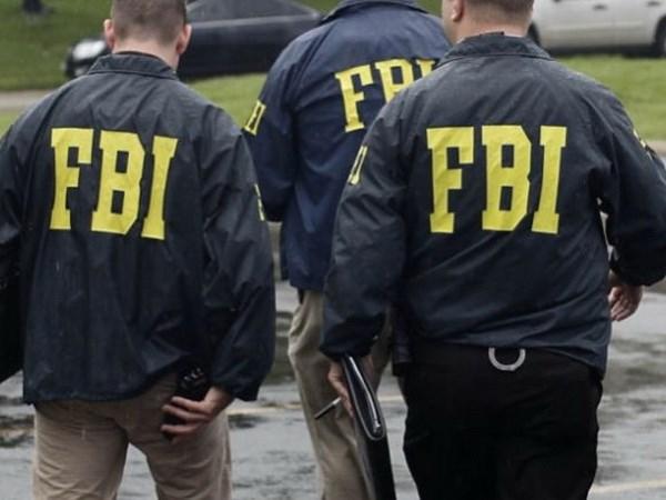 FBI bat giu 4 cong dan Nga voi cao buoc rua tien va gian lan hinh anh 1