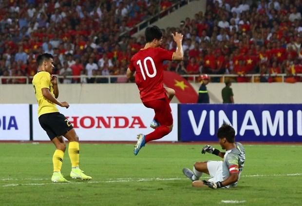 Quang Hai ha guc Malaysia, doi tuyen Viet Nam leo len nhi bang hinh anh 3