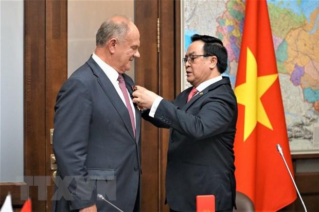 Doan dai bieu Dang Cong san Viet Nam lam viec tai Lien bang Nga hinh anh 1
