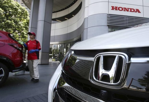 Honda Motor Co. - 60 nam 'truong ton' tren thi truong My hinh anh 1