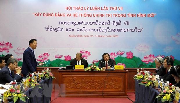 Hoi thao Ly luan lan thu VII giua DCS Viet Nam va Dang NDCM Lao hinh anh 1