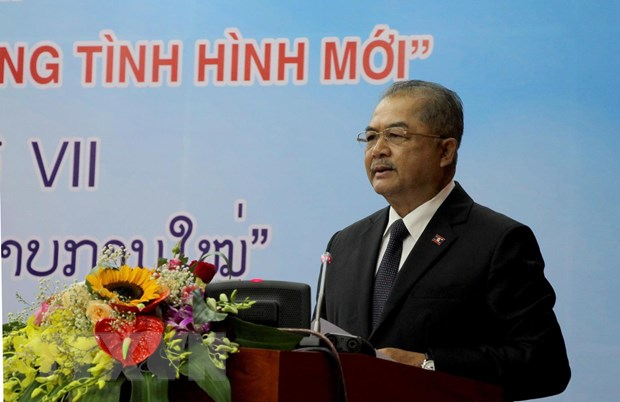 Hoi thao Ly luan lan thu VII giua DCS Viet Nam va Dang NDCM Lao hinh anh 2