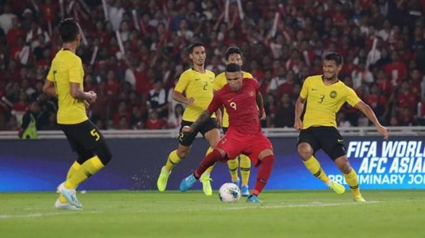 Ket qua vong loai World Cup: Viet Nam chia diem, Malaysia thang nguoc hinh anh 1