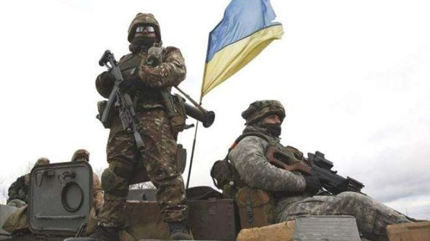 Chinh phu Ukraine va luc luong ly khai rut quan khoi khu vuc mien Dong hinh anh 1