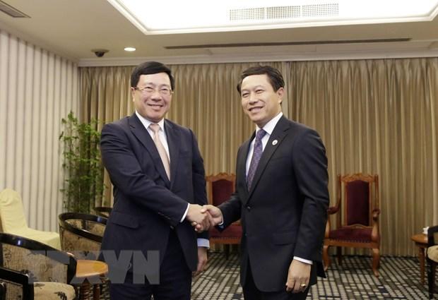 Pho Thu tuong gap song phuong Bo truong Trung Quoc va Bo truong Lao hinh anh 1