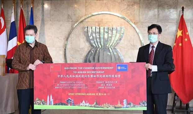 ASEAN hoan nghenh hop tac chong dich COVID-19 voi Trung Quoc hinh anh 1