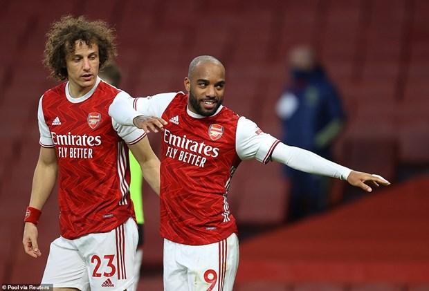 Premier League: Arsenal thang nguoc Tottenham, M.U tro lai top 2 hinh anh 1