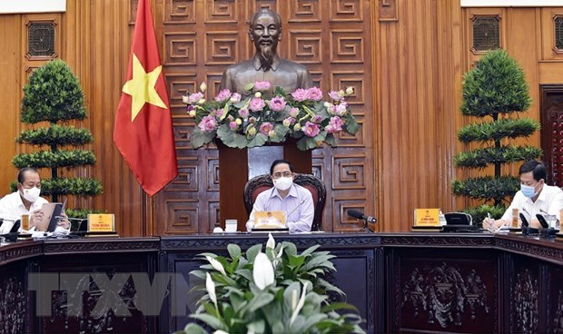 Thu tuong Pham Minh Chinh yeu cau don tong luc de dap dich COVID-19 hinh anh 1