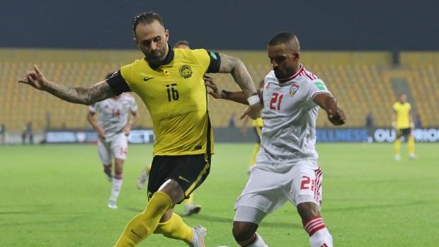 Malaysia (áo vàng) thảm bại trước UAE. (Nguồn: AFC)