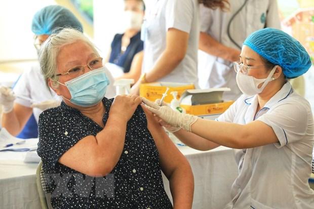 Thich ung an toan voi COVID-19: Hanh trinh bao phu vaccine toan cau hinh anh 1