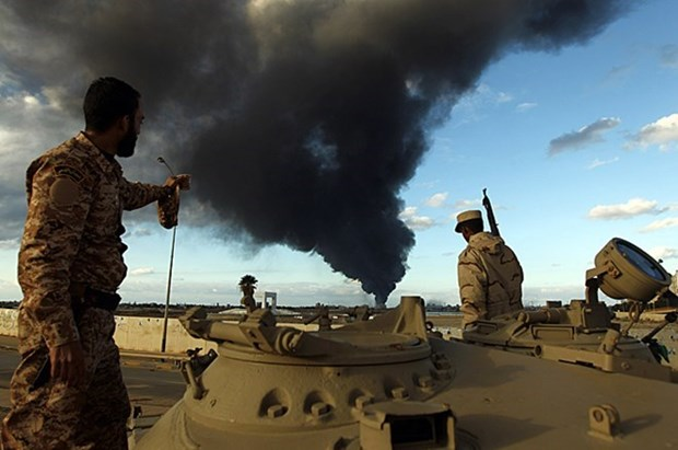 My san sang noi long cam van vu khi doi voi Libya de chong IS hinh anh 1