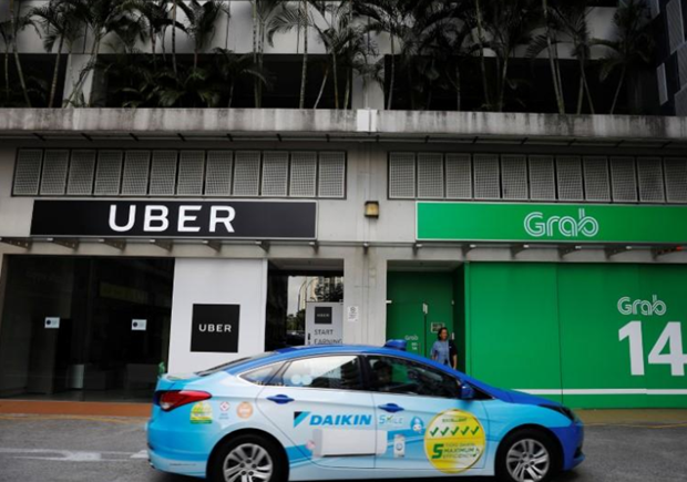 Uber, Grab dat thoa thuan ve chuyen giao thi truong Dong Nam A hinh anh 1