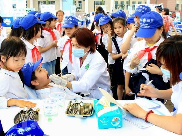Hoi nghi khoa hoc va Trien lam Rang Ham Mat quoc te lan thu 7 hinh anh 1