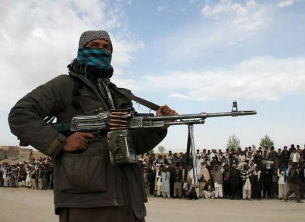 Phien quan Taliban tan cong, ban chet 20 canh sat Afghanistan hinh anh 1