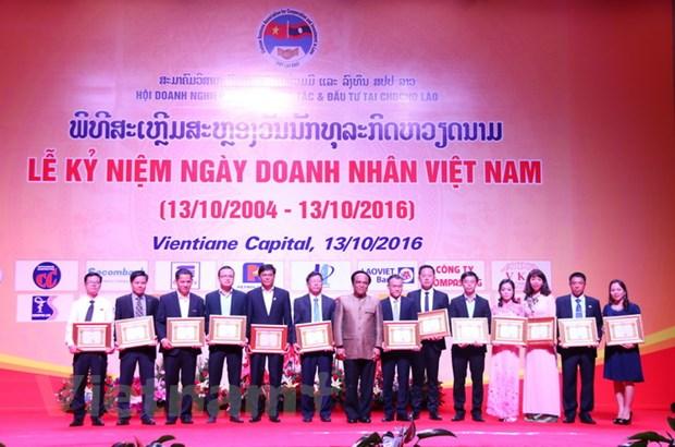 Hoi doanh nghiep Viet Nam tai Lao: Cau noi giao thuong hieu qua hinh anh 2