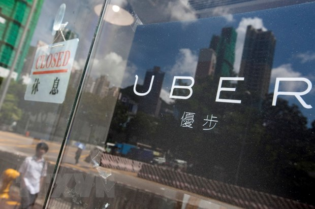 Hang loat tai xe taxi Uber tai Hong Kong bi canh sat bat giu hinh anh 1