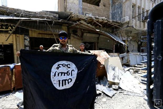 Iraq phat tu chung than cong dan Phap va Duc dau quan cho IS hinh anh 1