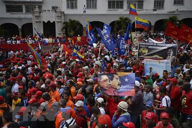 Dien Kremlin khong co y dinh so tan cong dan Nga khoi Venezuela hinh anh 1