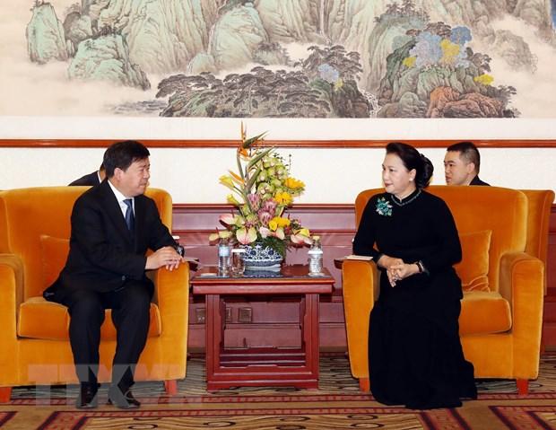 Chu tich Quoc hoi tham Dai su quan Viet Nam tai Trung Quoc hinh anh 3