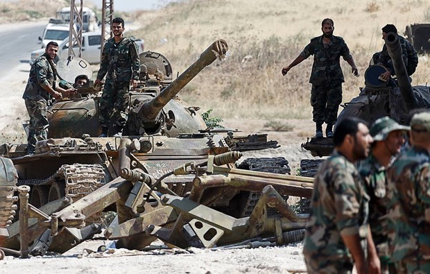 Quan doi Syria day lui cuoc tan cong khung bo o tinh Idlib hinh anh 1