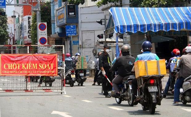 Thanh pho Ho Chi Minh ra soat lai doi tuong duoc phep ra duong hinh anh 1