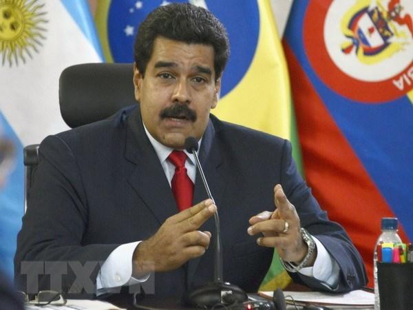 Venezuela yeu cau Interpol bat doi tuong muu sat tong thong hinh anh 1