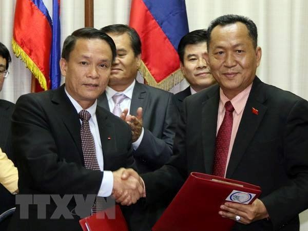 TTXVN-KPL ky thoa thuan hop tac nghiep vu giai doan 2016-2020 hinh anh 1