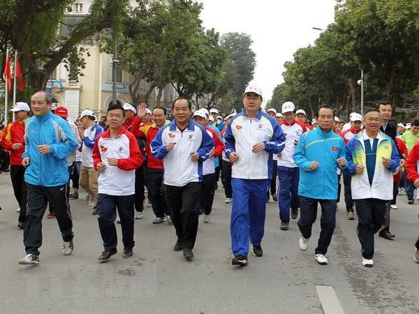 Hon 7.000 nguoi tham gia Ngay chay Olympic nam 2016 tai Ha Noi hinh anh 1