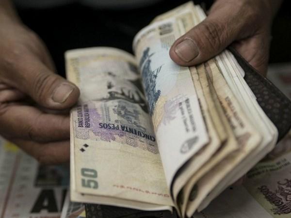 Argentina dat duoc thoa thuan goi vay 50 ty USD cua IMF hinh anh 1
