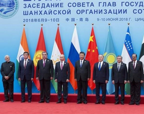 Bao chi Trung Quoc ca ngoi hoi nghi SCO, chi trich hoi nghi G7 hinh anh 1