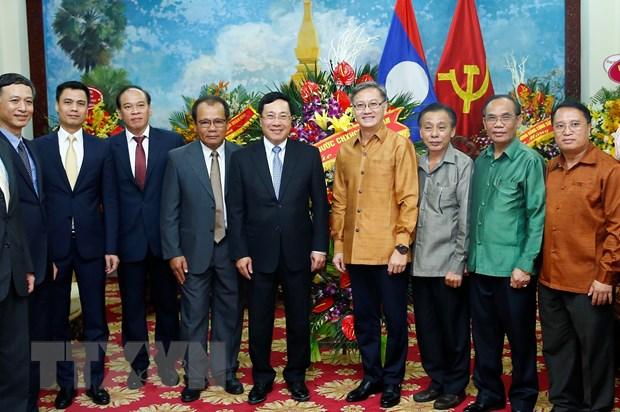 Pho Thu tuong Pham Binh Minh chuc mung Tet co truyen Bunpimay cua Lao hinh anh 1