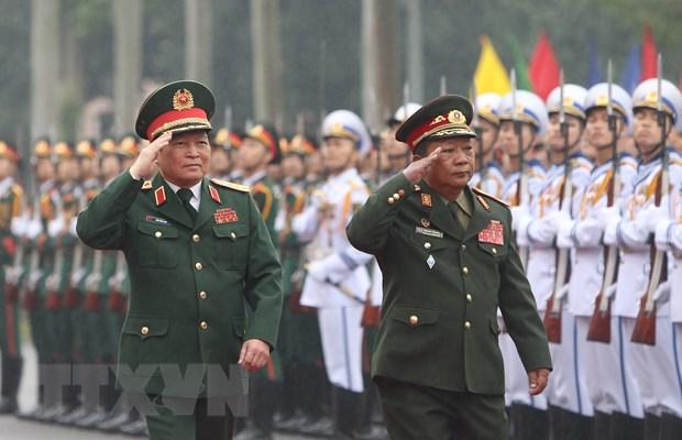 Bo truong Bo Quoc phong Lao tham, lam viec tai Viet Nam hinh anh 1