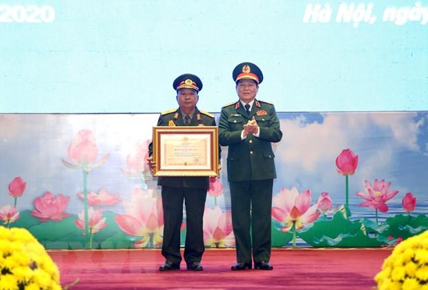 Trao Huan chuong cua Nha nuoc Viet Nam va Lao cho cac tap the, ca nhan hinh anh 1