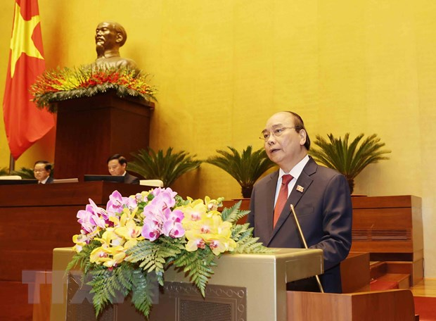 Chu tich nuoc Nguyen Xuan Phuc: Viet tiep ky tich tien len giau manh hinh anh 1