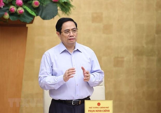 Thu tuong Pham Minh Chinh: Khong de khung hoang y te, khung hoang KTXH hinh anh 1