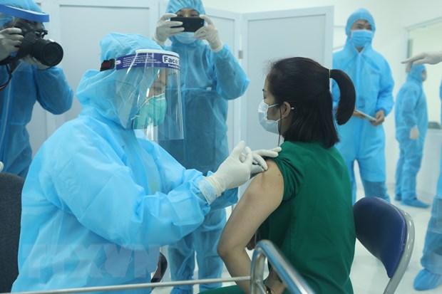 Hom nay, Viet Nam bat dau tiem vaccine phong COVID-19 tai nhieu noi hinh anh 1