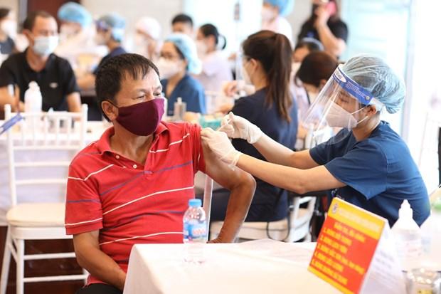 Bo Y te hoa toc yeu cau tiem vaccine COVID-19 theo dung huong dan hinh anh 1