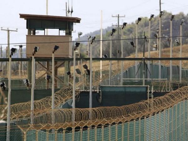 Ong Obama dung moi cach de som dong cua nha tu Guantanamo hinh anh 1