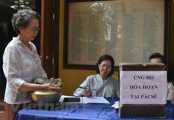 Cong dong nguoi Viet tai Lao mung dai le Phat Dan 2016 hinh anh 2