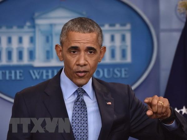 Tong thong Obama giam an cho hang tram tu nhan truoc khi roi nhiem so hinh anh 1