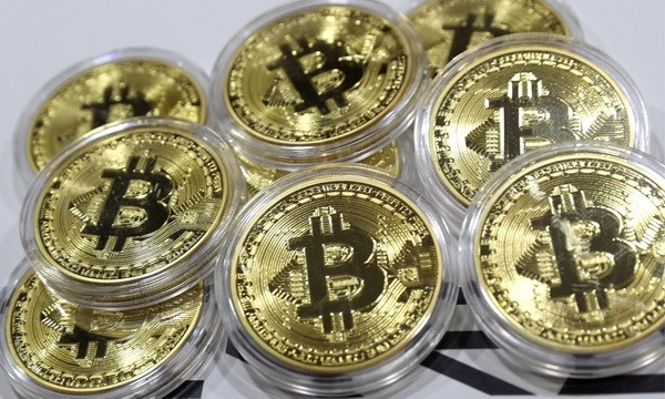 Gia tri dong tien ao Bitcoin lan dau tien pha moc 5.000 USD hinh anh 1