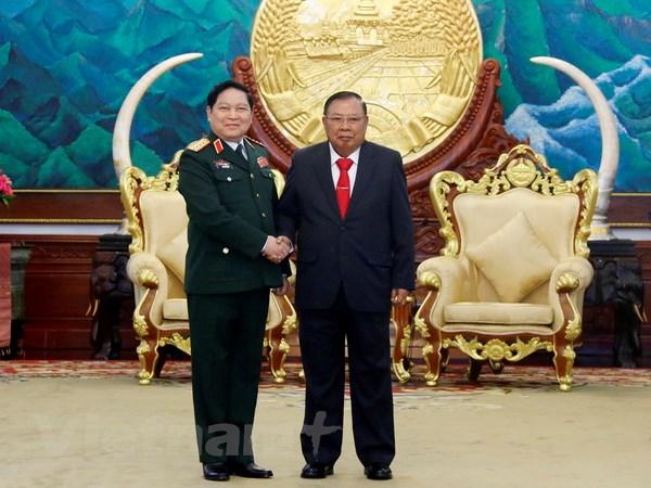 Lao-Viet cung nhau xay dung duong bien gioi hoa binh huu nghi hinh anh 1